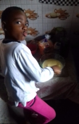 Our sister Comfort whisking the batter